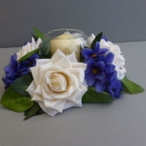 Candle ring with artificial ivory roses & African violets