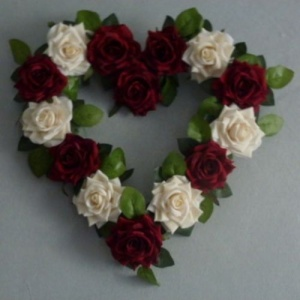 Wreath with artificial dark red & ivory roses