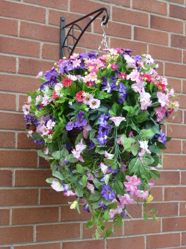 hanging baskets with artificial purple and pink petunias g. Black Bedroom Furniture Sets. Home Design Ideas