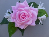 Corsage with artificial pink rose