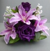 Centerpiece for wedding table with artificial cadbury purple roses & lilies
