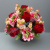 Pot for memorial vase with artificial red roses and pink scabiosa