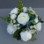 Centerpiece for wedding table with artificial ivory roses & peonies