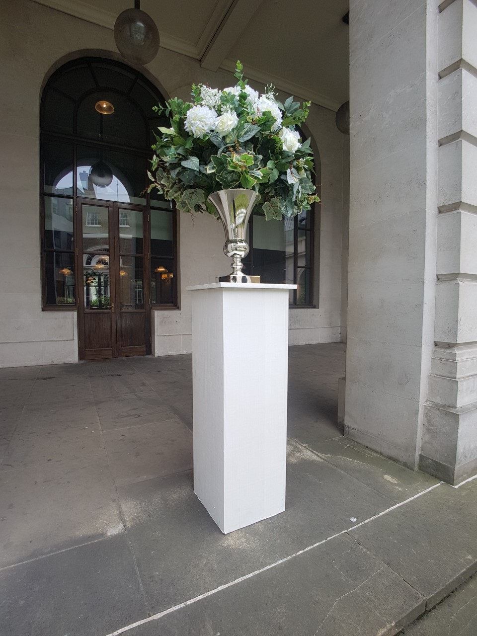 Artificial Flower arrangement into urn
