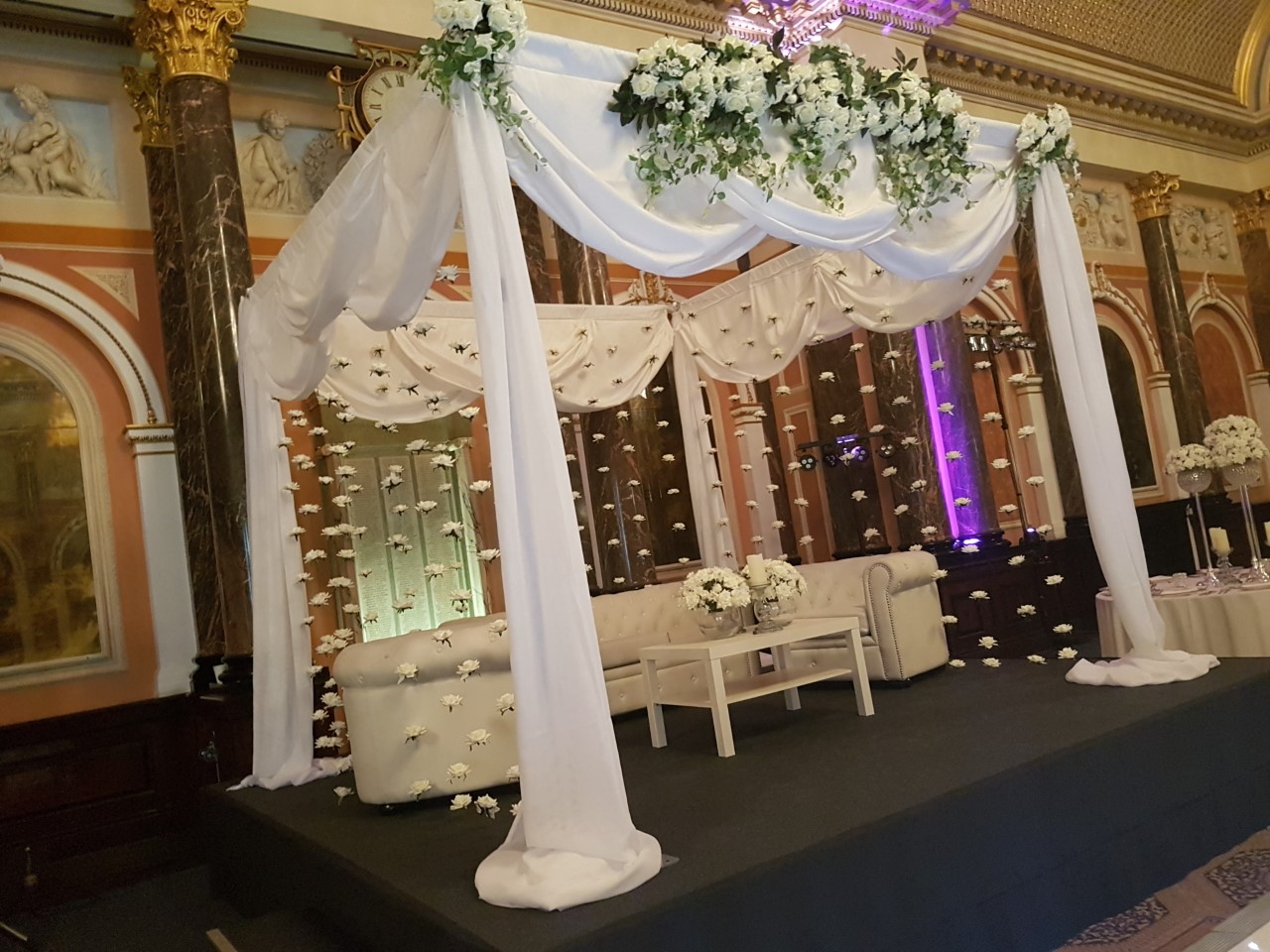 Canopy decorated with ivory roses