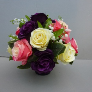 Pot for memorial vase with artificial pink purple yellow roses