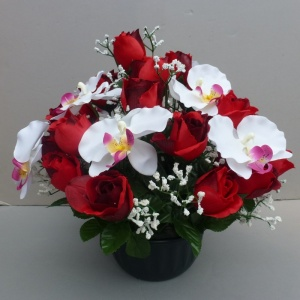 Large freestanding artificial flower pot with red rosebuds and white orchids