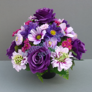Pot for memorial vase with artificial purple roses and lilac scabiosa