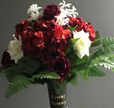 Spike vase with burgundy ivory roses and hydrangea