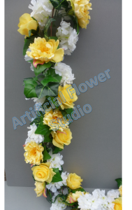 Luxurious Garland with yellow roses and peonies