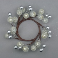 Christmas candle ring with artificial silver berries