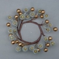 Christmas-candle ring with artificial gold berries