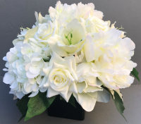Centerpiece for wedding table with artificial ivory roses & hydrangeas