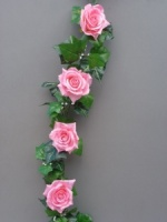 Garland with artificial pink silk roses