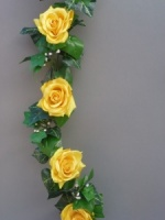 Garland with artificial yellow silk roses