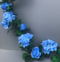 Garland with light blue roses and hydrangeas