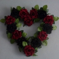 Wreath with artificial dark red & black roses