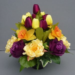 Cemetery pot with artificial purle roses  and yellow peonias